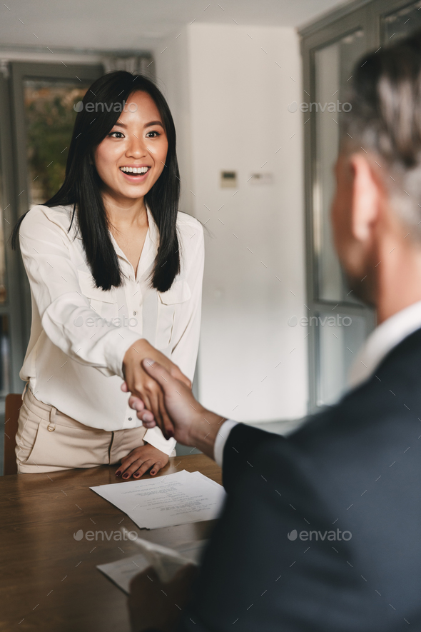 Business, career and placement concept - happy asian woman hands - Stock Photo - Images