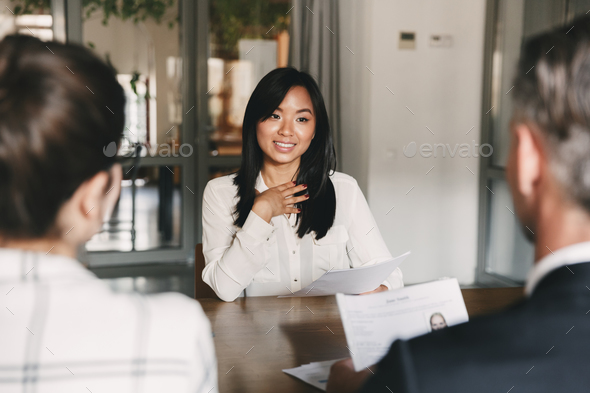 Business, career and placement concept - young asian woman smili - Stock Photo - Images
