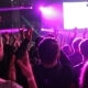 Fans Wave Their Hands To the Beat of the Music at the Concert - VideoHive Item for Sale