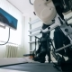 Man's Legs in Bonds of a Training Machine During Walking Exercises. Electronic Medical Robotic - VideoHive Item for Sale