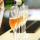 Pouring prosecco into glasses in close up - PhotoDune Item for Sale