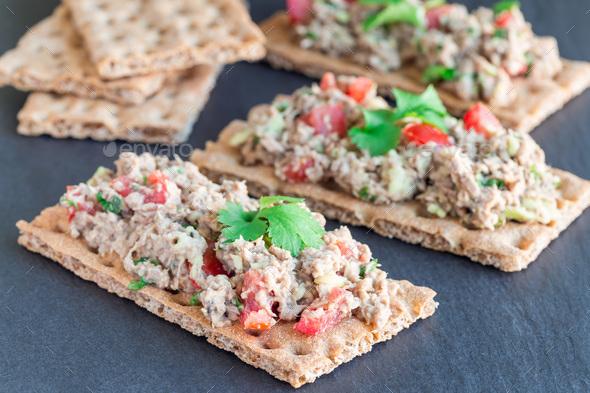 Salad with tuna, avocado, tomatos, coriander and lemon juice, se - Stock Photo - Images