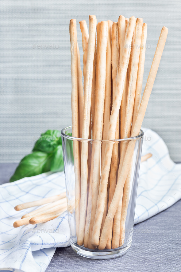 Traditional Italian snack grissini bread sticks in glass with ba - Stock Photo - Images