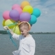 Happy Young Boy Walks with Colourful Balloons on the Shore of the Lake - VideoHive Item for Sale