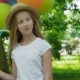 Portrait of Pretty Girl Poses at Camera with Colourful Balloons in Sunny Park - VideoHive Item for Sale