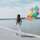 Happy Young Girl Walks with Colourful Balloons on the Shore of the Lake - VideoHive Item for Sale
