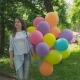 Portrait of Happy Girl Poses and Turns Around at Camera with Balloons in Park - VideoHive Item for Sale