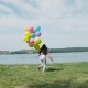 Happy Young Girl Running with Colourful Balloons To the Lake the Lake - VideoHive Item for Sale