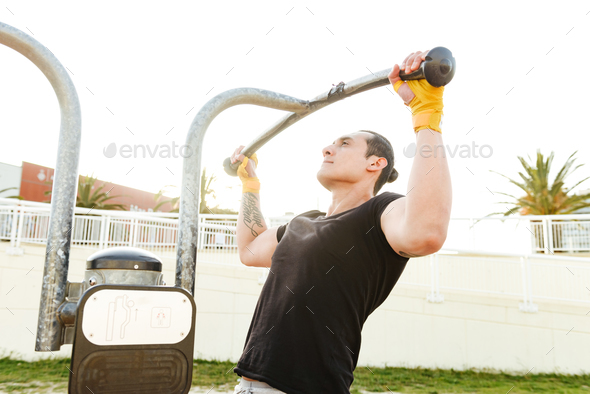 Handsome young sportsman make exercises - Stock Photo - Images