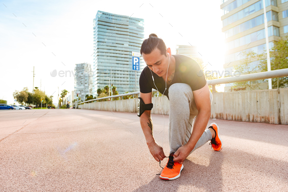 Handsome sportsman standing outdoors - Stock Photo - Images