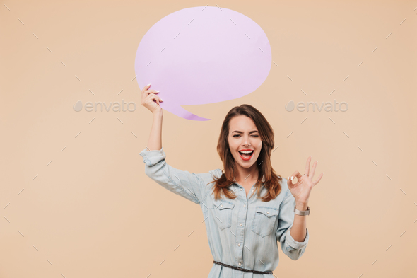 Happy woman holding speech bubble make okay gesture. - Stock Photo - Images