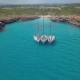 Top View of the Sailing Boats in Blue Lagoon. Swimmers Enjoying in Clear Blue Sea - VideoHive Item for Sale