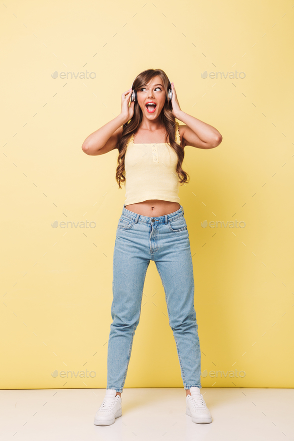 Full length photo of joyful woman 20s with long brown hair weari - Stock Photo - Images