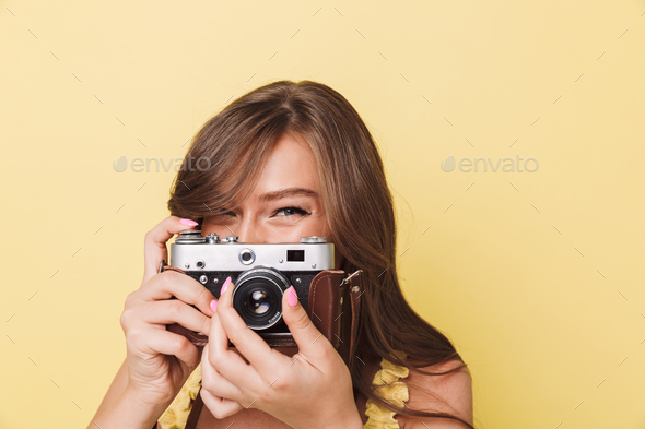 Close up portrait of a pretty young girl taking picture - Stock Photo - Images