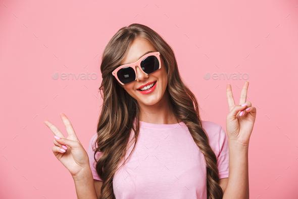 Image closeup of caucasian woman wearing posh sunglasses smiling - Stock Photo - Images