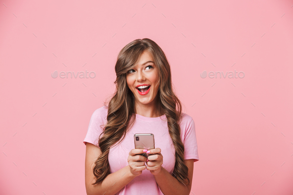 Image of adorable woman 20s with long curly hair and playful loo - Stock Photo - Images