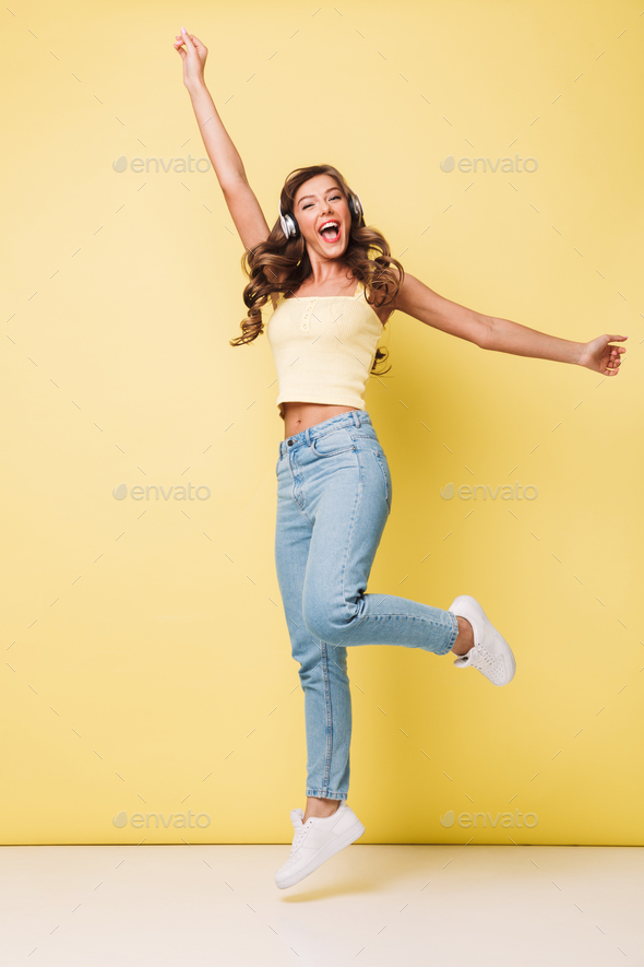 Full length photo of positive pretty woman 20s with long brown h - Stock Photo - Images