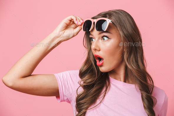 Photo closeup of shocked woman 20s looking aside at copyspace wi - Stock Photo - Images