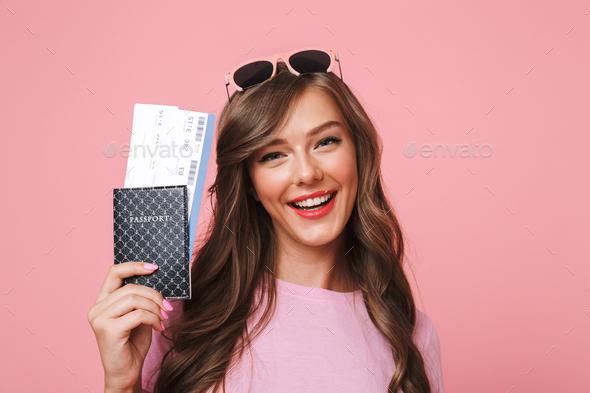 Image of european woman having beautiful brown locks smiling whi - Stock Photo - Images