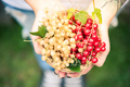 Young female holding freshly picked homegrown fruits - PhotoDune Item for Sale