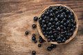 Fresh ripe blackcurrant in basket, copy space on wooden board - PhotoDune Item for Sale