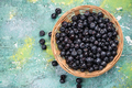 Fresh ripe blueberry  in basket, copy space on wooden board - PhotoDune Item for Sale