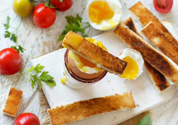 Soft-boiled egg with toasts - Stock Photo - Images