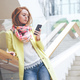 Redhair woman texting on the smart phone - PhotoDune Item for Sale