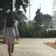 Fashionable Brunette Walking in Beautiful Morning Park - VideoHive Item for Sale