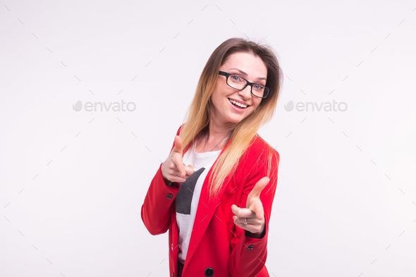 Pointing stylish business lady in red fashionable suit and glasses on white background. - Stock Photo - Images