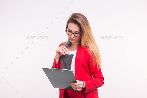 Portrait of young business woman in red jacket wih paper clip in hands. - Stock Photo - Images
