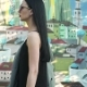 Fashionable Brunette in Sunglasses Walking in  Against Graffiti Wall - VideoHive Item for Sale