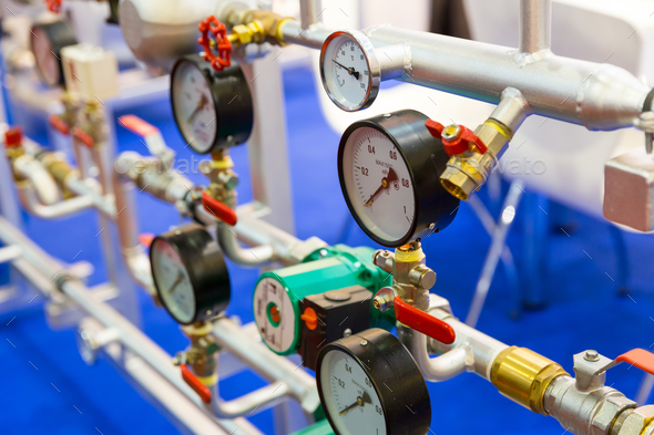 Pressure gauge, valves on  pipeline, heat circuit - Stock Photo - Images