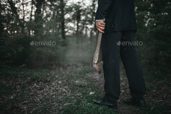 Bloody murderer with an axe, serial maniac concept - Stock Photo - Images