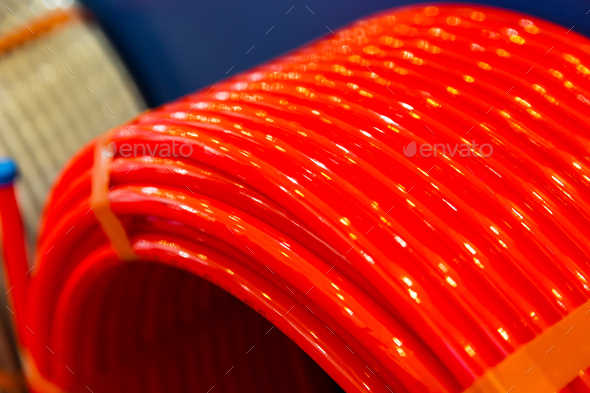 Roll of of plastic pipe in plumbing shop, pvc - Stock Photo - Images