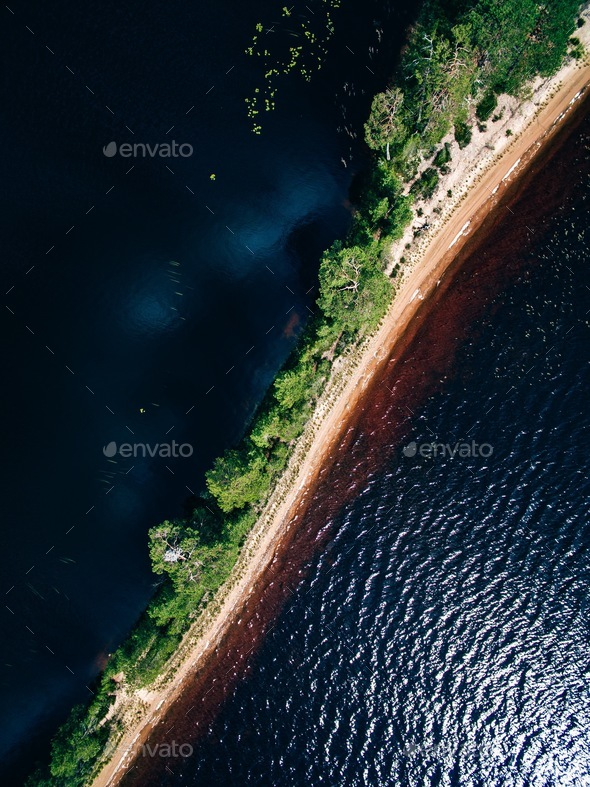 Aerial view of the sand spit with forest. Summer landscape with a blue lake in Finland - Stock Photo - Images