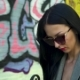 Portrait of Gorgeous Brunette Against Graffiti Wall - VideoHive Item for Sale