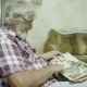Mature Man Looking His Old Album with Photos - VideoHive Item for Sale