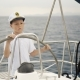 Little Children Skipper at the Helm Controls of a Sailing Yacht - VideoHive Item for Sale