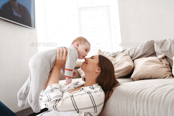 Mother having fun with her little child indoors at home. - Stock Photo - Images