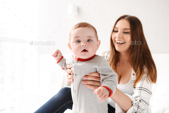 Happy young woman mother having fun with her little child - Stock Photo - Images