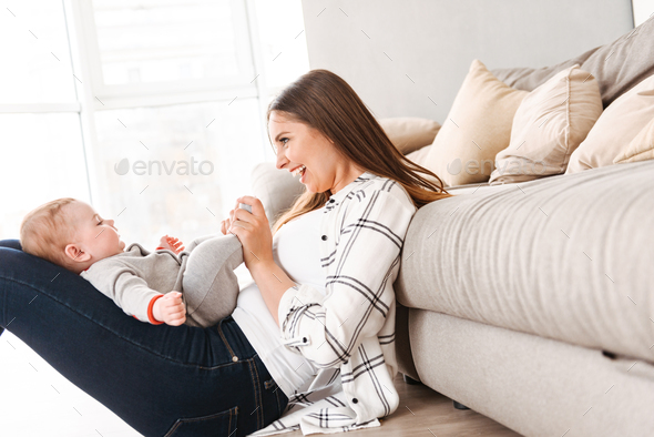 Happy young woman mother having fun with her little son - Stock Photo - Images