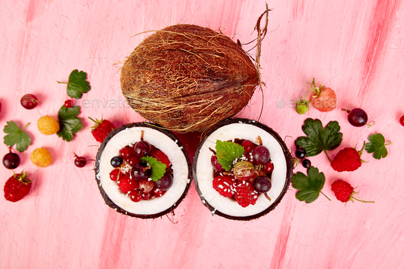 Fruit salad in coconut shell bowl - Stock Photo - Images