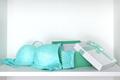 Open gift box with lingerie set on white shelf inside closet - PhotoDune Item for Sale
