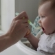Mother's Hand with Spoon Feeding Cute Baby - VideoHive Item for Sale