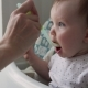 Hand of Mother Feeds Baby - VideoHive Item for Sale