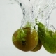Conference Pears Are Immersed in Water with Bubbles. Pears on White Isolated Background - VideoHive Item for Sale