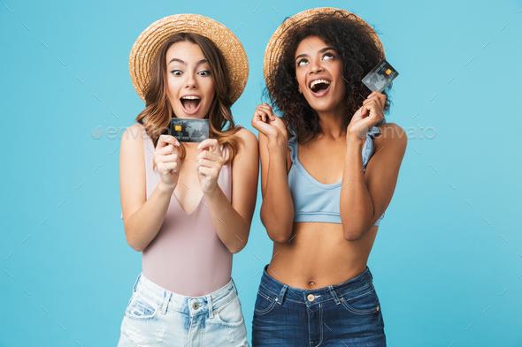Photo of two joyful multiethnic women 20s wearing straw hats and - Stock Photo - Images