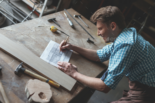 Young man in the carpentry - Stock Photo - Images