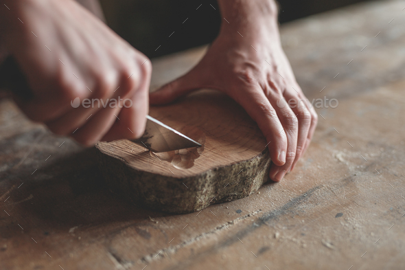 Men's hands with wood in carpentry - Stock Photo - Images